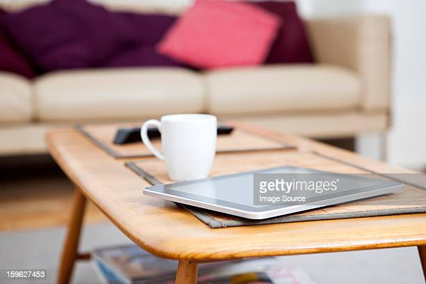 Digital tablet on coffee table