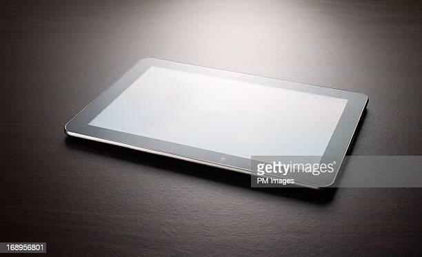 Digital tablet on table top