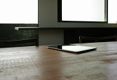 A digital tablet on the table
