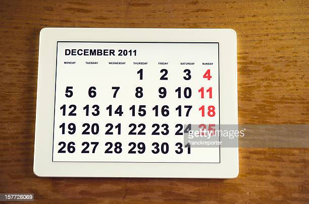 Digitale tablet mit 2011 Dezember Tagesordnung Kalender auf Tisch