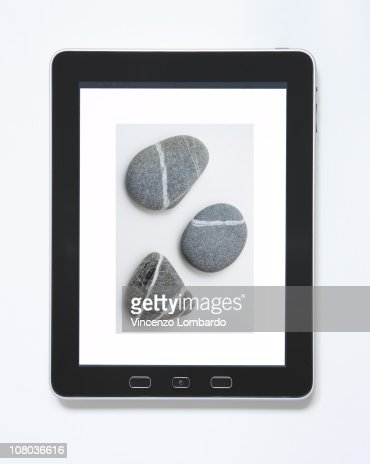 Digital Tablet  With a Picture of Three Stones : Stock Photo