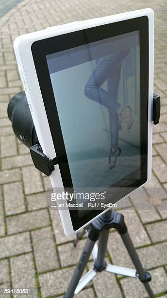 Digital Tablet With Lens Photographing Low Section Of Woman On Street