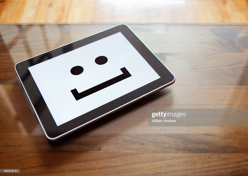 Digital tablet with smile emoticon