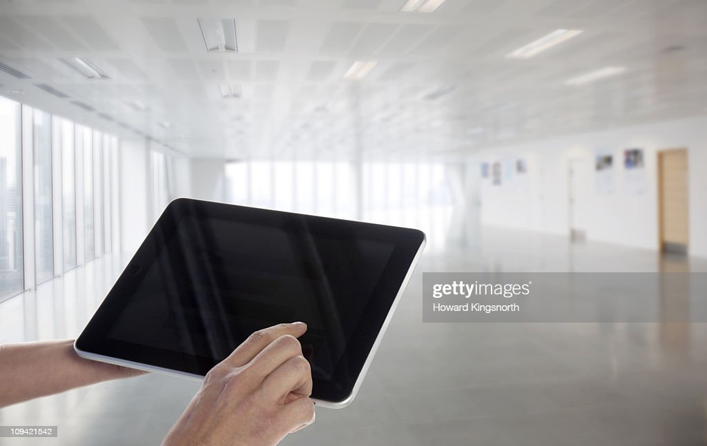 Digital tablet within new office environment : Stock Photo