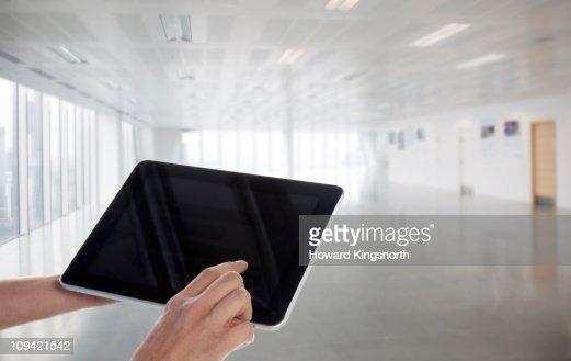 Digital tablet within new office environment : Foto de stock