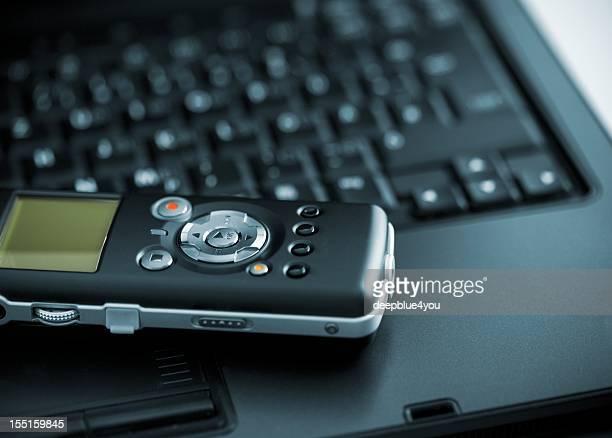 Digital Voice Recorder lying on laptop