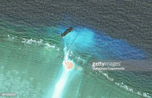 DigitalGlobe closeup imagery of one of the Cuarteron Reef The Cuarteron Reef is located at the east end of the London Reefs in the Spratly Islands of...