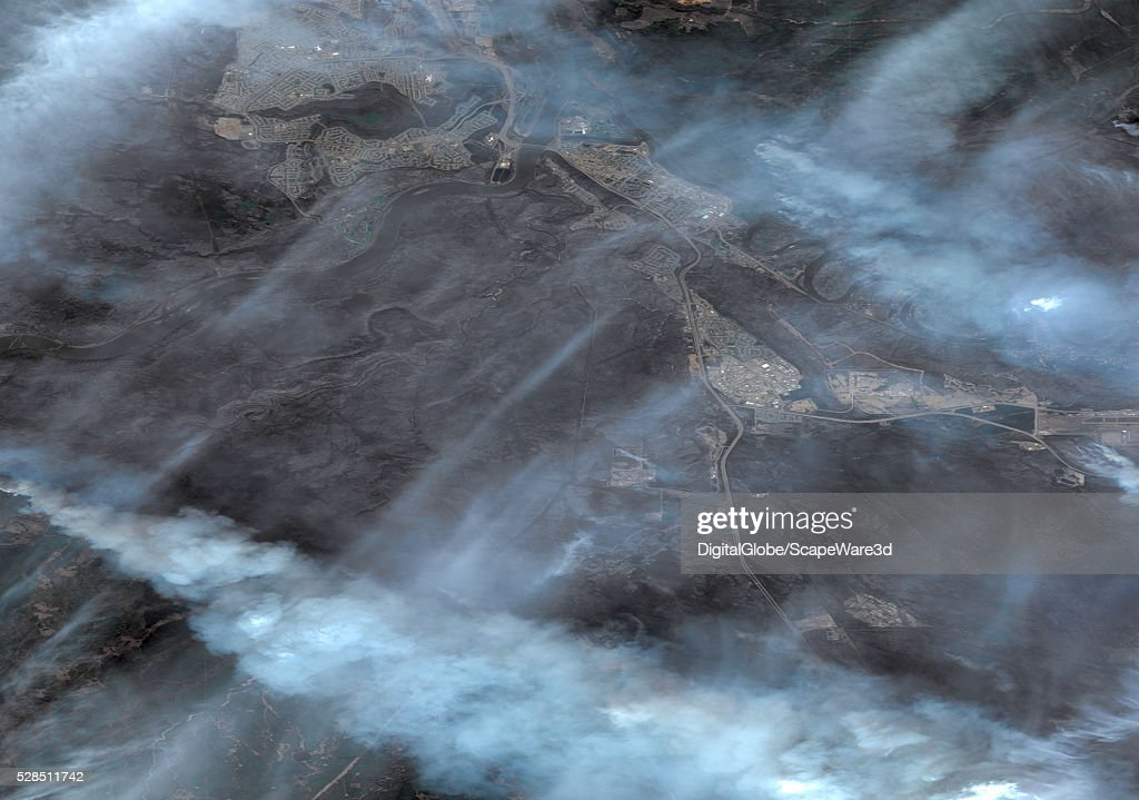 DigitalGlobe image of a charred Fort MacMurray in Alberta following the devestating wildfire that destroyed the town. A landscape that should be covered in green vegitation has been blackened by the fire. Image was taken on May 5th, 2016.
