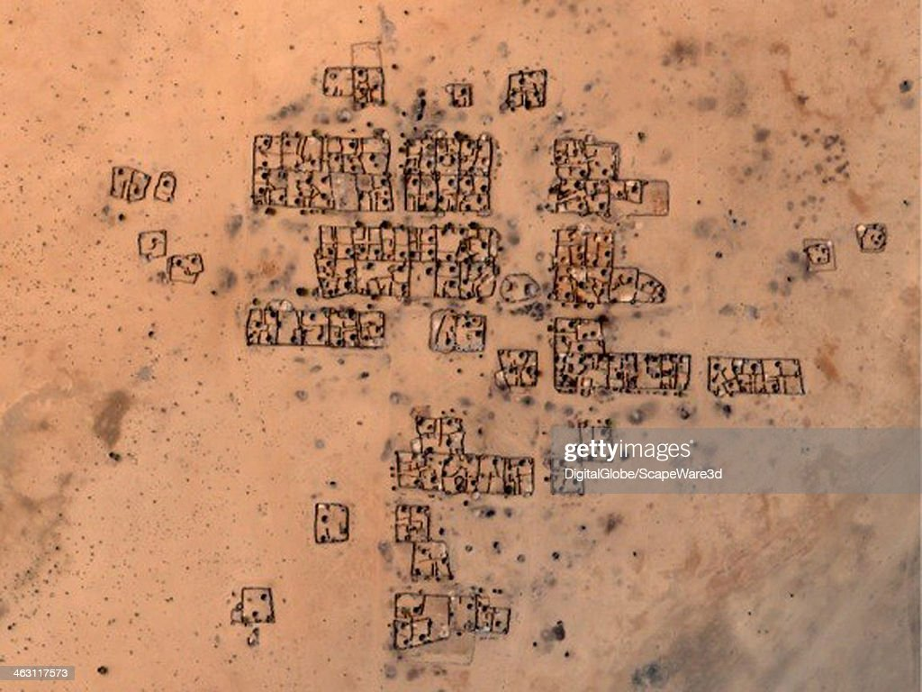DigitalGlobe Satellite Imagery of before damage occurred to the village of Shangil in the Tobay Shadad region in Sudan. Photo DigitalGlobe via Getty Images.