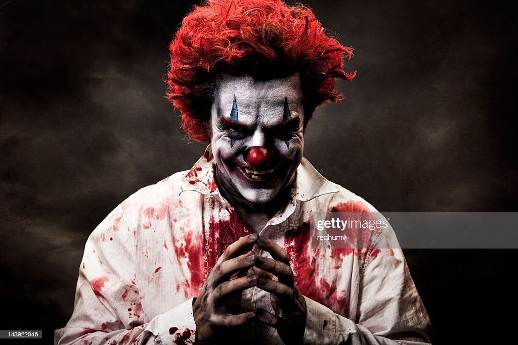 Digitally altered image of evil, bloody clown : Stock Photo