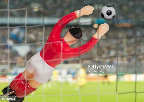Digitally generated close up image of soccer goalkeeper in stadium