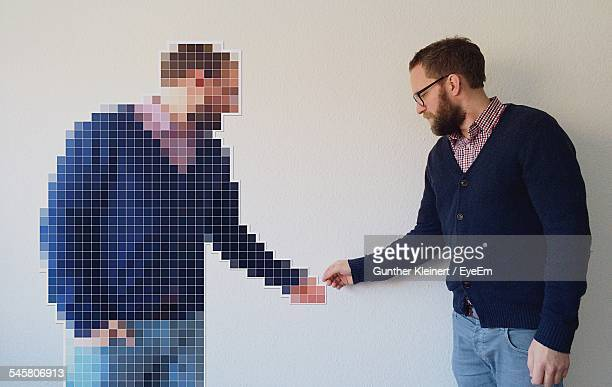 Digitally Generated Image On Man Shaking Hands With Himself At Home