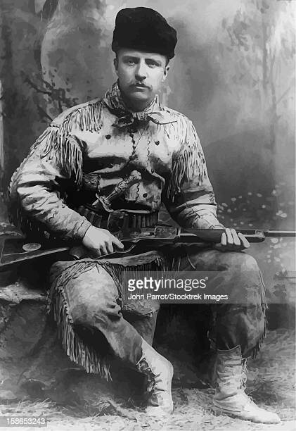 Digitally restored vector portrait of a young Theodore Roosevelt with his high-decorated deer-skin hunting suit, and carved Tiffany hunting knife and rifle. Circa 1885.
