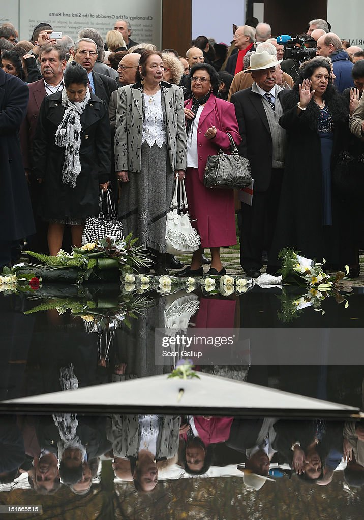 """Dignitaries and members of the public attend the inauguration of the """"Memorial to the Sinti and Roma of Europe Murdered Under National Socialism"""" on October 24, 2012 in Berlin, Germany. In addition to targeting Jews during the Holocaust, Hitler also sought to exterminate the Roma population in Europe and estimates of the number killed range from 220,000 to 1,500,000."""