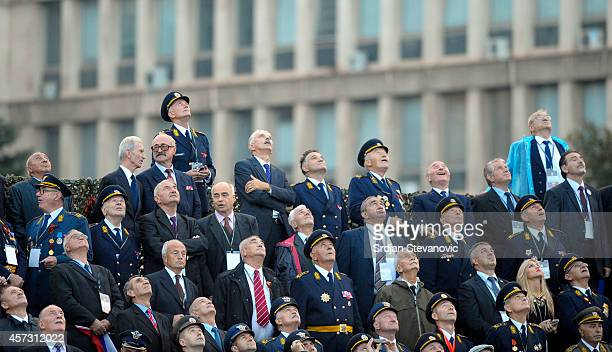 Dignitaries attend a military parade on October 16 2014 in Belgrade Serbia Vladimir Putin was in Belgrade to attend the 70th anniversary of...