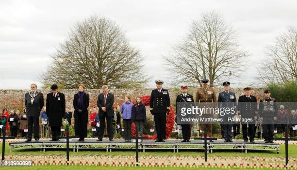 Dignitaries including Mayor of Royal Wootton Basset Mike Leighfield left Royal British Legion's Vice Chairman Mr John Crisford Private Aron Shleton...