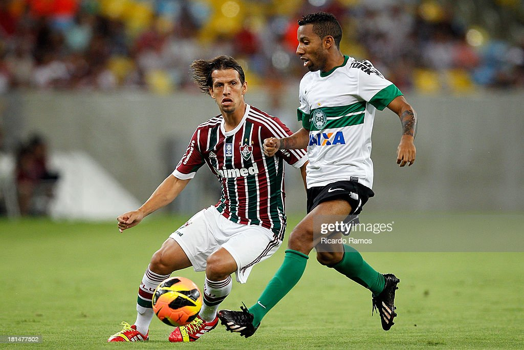 Diguinho of Fluminense fight for the ball with Vitor Junior of Coritiba during the match between Fluminense and Coritiba for the Brazilian Series A 2013 at Maracana on September 21, 2013 in Rio de Janeiro, Brazil.