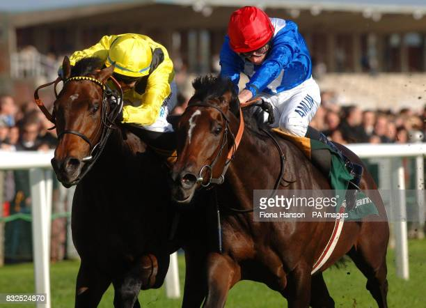 Dijeerr and jockey Philip Robinson wins the Stan James Horris Hill Stakes from Mythical Kid and jockey Ryan Moore at Newbury Racecourse