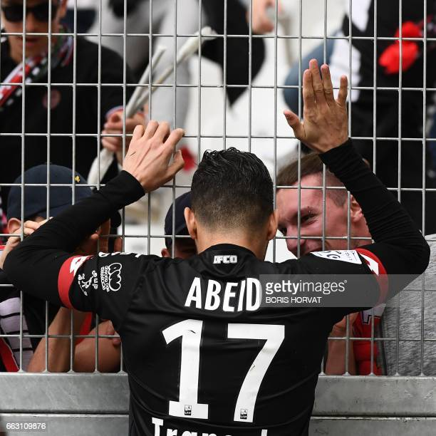 Dijon's Algerian midfielder Mehdi Abeid celebrates with supporters after scoring during the French L1 football match Olympique of Marseille vs Dijon...