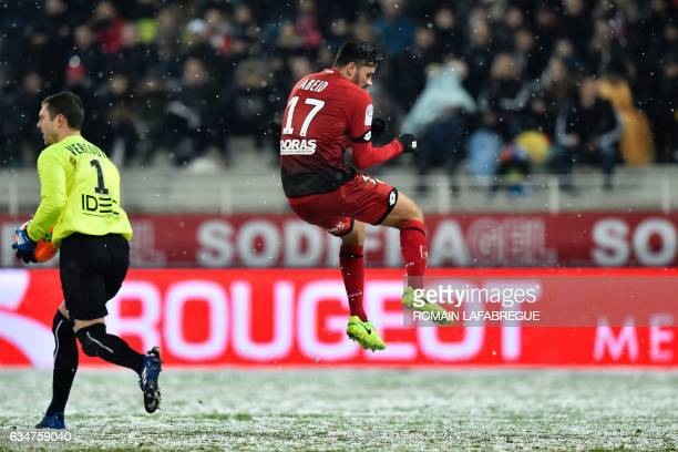 Dijon's Algerian midfielder Mehdi Abeid jumps during the French L1 football match between Dijon and Caen at the GastonGerard Stadium in Dijon central...