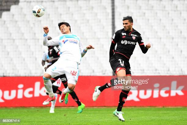 Dijon's Algerian midfielder Mehdi Abeid vies for the ball with Olympique de Marseille's Japanese defender Hiroki Sakai during the French L1 football...