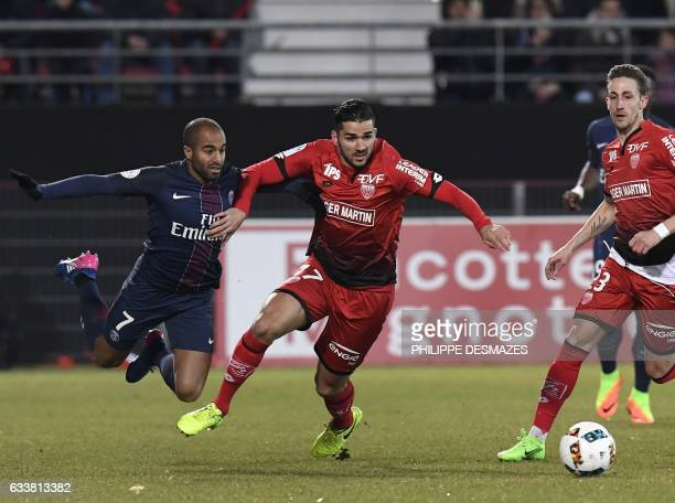 Dijon's Algerian midfielder Mehdi Abeid vies with Paris SaintGermain's Brazilian midfielder Lucas Moura during the French L1 football match between...