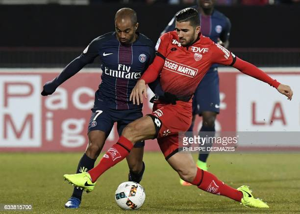 Dijon's Algerian midfielder Mehdi Abeid vies with Paris SaintGermain's Brazilian midfielder Lucas Moura during the French Ligue 1 football match...