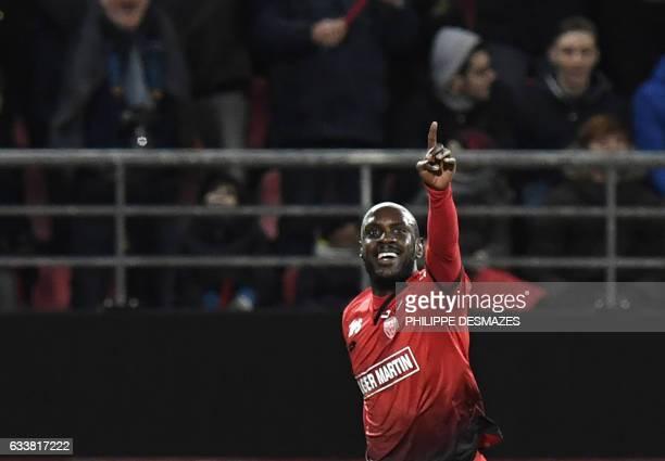 Dijon's Cap Verdean forward Julio Tavares celebrates after scoring during the French L1 football match between Dijon FCO and Paris SaintGermain on...