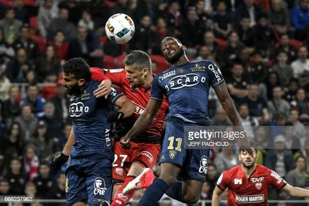 Dijon's French defender Cedric Varrault vies with Bastia's Morrocan defender Abdelhamid El Kaoutari and Bastia's French midfielder Lenny Nangis...