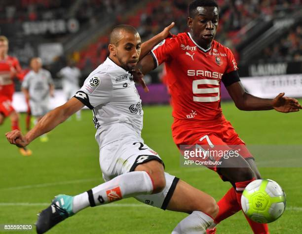 Dijon's French defender Fouad Chafik vies with Rennes' French midfielder Faitout Maouassa during the French L1 football match between Rennes and...