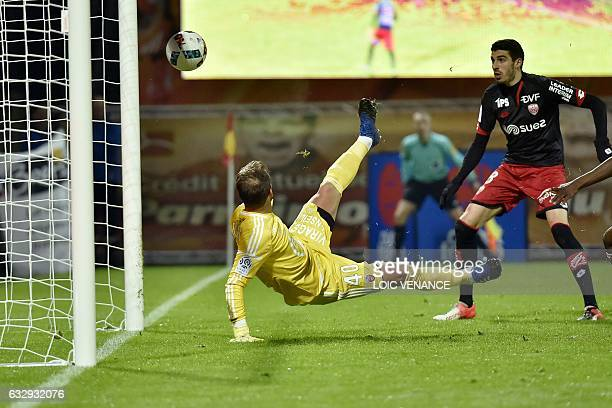 Dijon's French defender Jordan Loties scores past Lorient's French goalkeeper Benjamin Lecomte during the French L1 football match between Lorient...