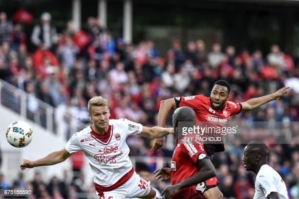 Dijon's French defender Jordan Loties vies with Bordeaux' Polish defender Igor Lewczuk during the French L1 football match Dijon vs Bordeaux on April...
