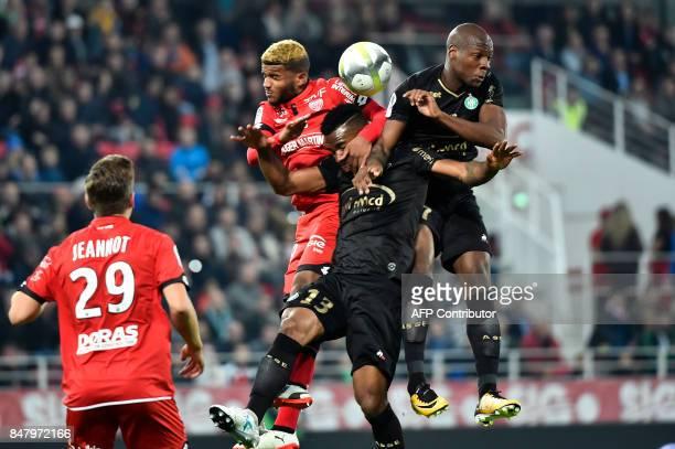 Dijon's French defender Valentin Rosier heads the ball with SaintEtienne's Ivorian midfielder Habib Maiga and SaintEtienne's French midfielder Bryan...