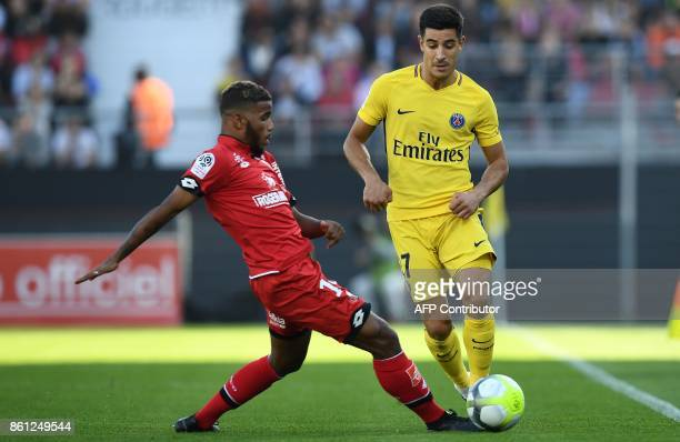 Dijon's French defender Valentin Rosier vies with Paris SaintGermain's Spain defender Yuri Berchiche during the French L1 football match between...