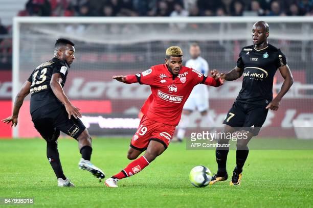 Dijon's French defender Valentin Rosier vies with SaintEtienne's Ivorian midfielder Habib Maiga and SaintEtienne's French midfielder Bryan Dabo...