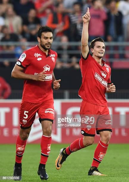 Dijon's French forward Benjamin Jeannot celebrates his goal during the French L1 football match between Dijon and Paris SaintGermain at the Gaston...