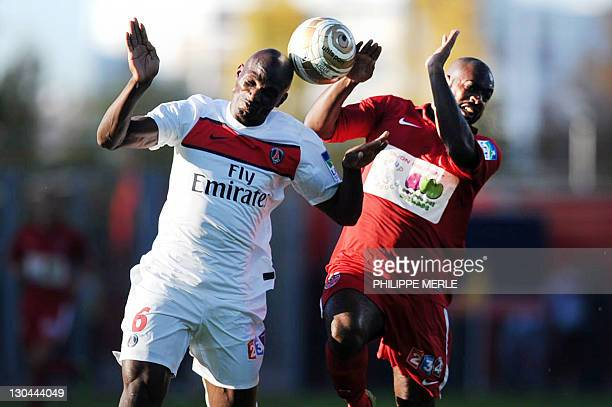 Dijon's French forward Brice Jovial vies with Paris' French defender Zoumana Camara during the French League Cup match Dijon vs Paris on October 26...