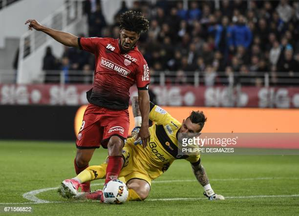 Dijon's French forward Lois Diony dribbles Angers' French goalkeeper Alexandre Letellier and scores during the French L1 football match between Dijon...