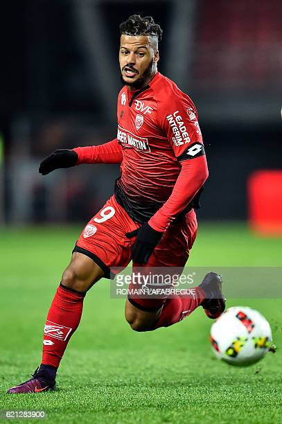 Dijon's French forward Lois Diony looks at the ball during the French L1 football match between Dijon and Guingamp at the GastonGerard stadium in...