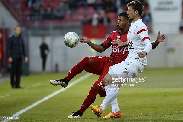Dijon's French forward Lois Diony vies with Nancy's French defender Clement Lenglet during the French L2 football match Dijon vs Nancy on May 22 at...