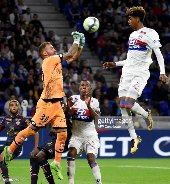 Dijon's French goalkeeper Baptiste Reynet vies with Lyon's forward Willem Geubbels during the French L1 football match Lyon vs Dijon on September 23...