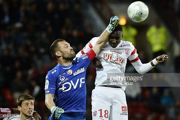 Dijon's French goalkeeper Baptiste Reynet vies with Nancy's French defender Modou Diagne during the French L2 football match Dijon vs Nancy on May 22...