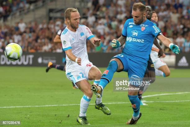 Dijon's French goalkeeper Baptiste Reynet vies with Olympique de Marseille's French forward Valere Germain during the French L1 football match...