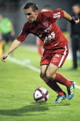 Dijon's French midfielder Eric Bautheac runs with the ball during the French L1 football match Dijon vs Ajaccio on October 2011 at the Gaston Gerard...