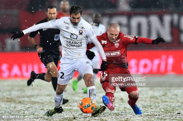 Dijon's French midfielder Florent Balmont vies with Caen's French defender Nicolas Seube during the French L1 football match between Dijon and Caen...