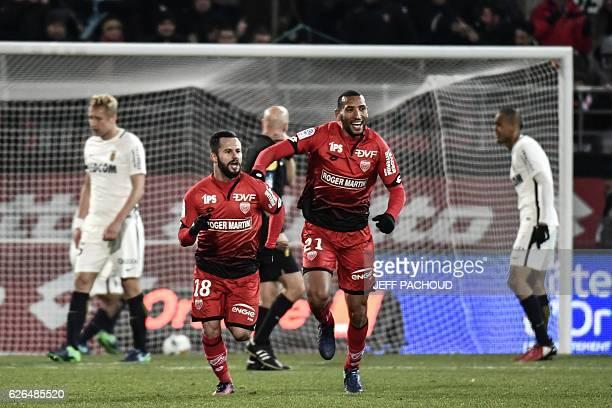 Dijon's French midfielder Frederic Sammaritano celebrates after scoring a goal during the French L1 football match Dijon vs Monaco on November 29...