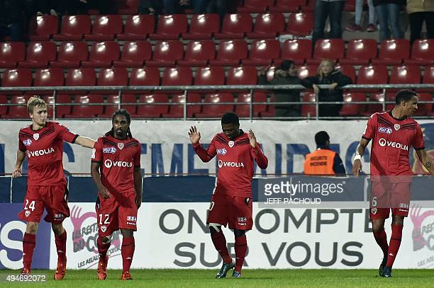 Dijon's French midfielder Jeremie Bela celebrates after scoring a goal during the round of 32 Ligue Cup football match Dijon vs Reims on October 28...