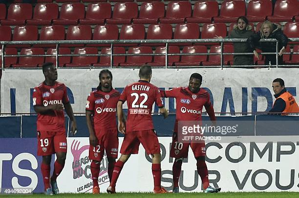 Dijon's French midfielder Jeremie Bela celebrates with his teammates after scoring a goal during the French Ligue Cup round of 32 football match...