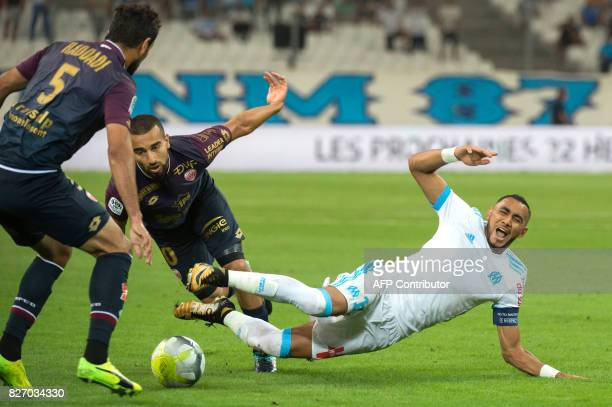 Dijon's French midfielder Jeremie Bela vies with Olympique de Marseille's French forward Dimitri Payet during the French L1 football match Olympique...