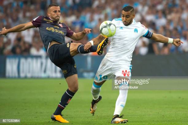 Dijon's French midfielder Jordan Marie vies with Olympique de Marseille's French forward Dimitri Payet during the French L1 football match Olympique...